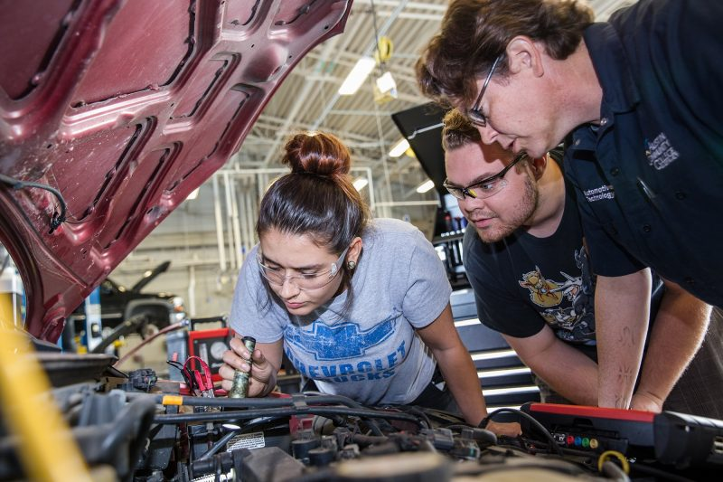 ACC students working on a car